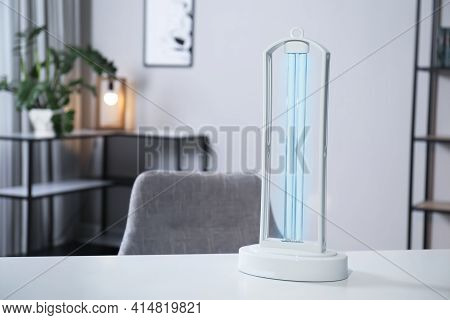 Uv Sterilizer Lamp On Table At Home. Space For Text