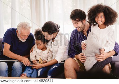 Lovely Home Happy Family Living Together In Living Room Father Mother And Grandfather Playing With D