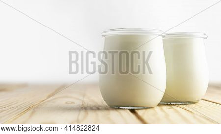 Front View Plain Yogurt In Jars. High Quality And Resolution Beautiful Photo Concept