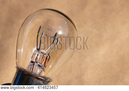A Close-up Of A Filament Of An Automobile Envelope Lamp. Retro Lamp