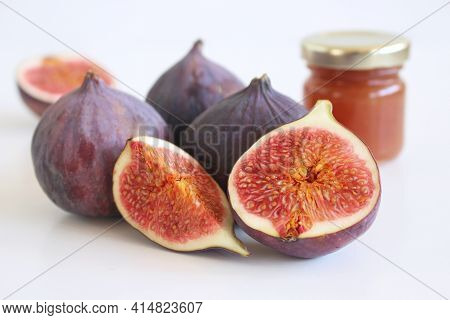 Fresh Ripened Purple Figs. Creative Composition A Decorative Banner Of Whole And Sliced Exotic Fruit