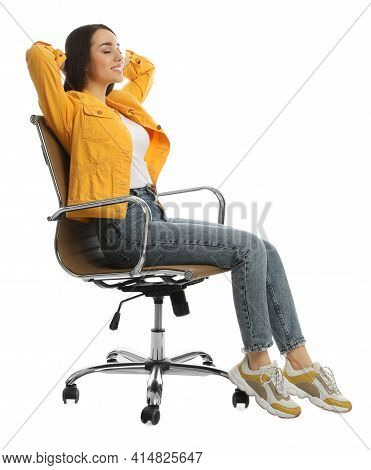 Young Woman Relaxing In Comfortable Office Chair On White Background