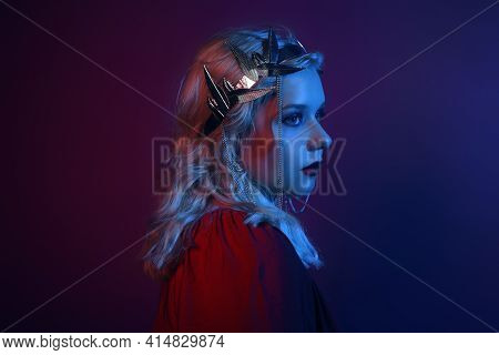 Portrait In Neon Of A Woman In A Silver Crown With Chains. A Girl As A Princess, Queen, Princess. Fa
