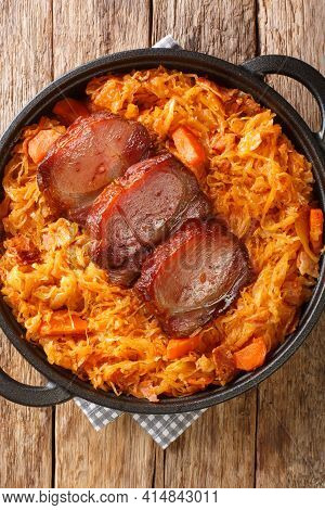 Podvarak Serbian Baked Sauerkraut With Smoked Meat Closeup In The Pan On The Table. Vertical Top Vie