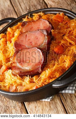 Podvarak Serbian Baked Sauerkraut With Smoked Meat Closeup In The Pan On The Table. Vertical