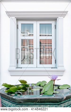 Front View Of Window Vintage Styles With Exterior Decoration, Double Transparent Glass Windows And A