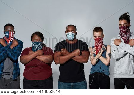 Young Multiracial People In Masks Standing With Crossed Hands Side By Side During Anti Racism Meetin