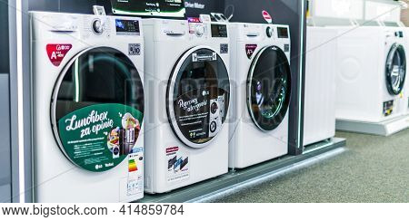 Poznan, Pol - Feb 24, 2021: Front-loader Washing Machines By Lg Put Up For Sale In A Household Goods