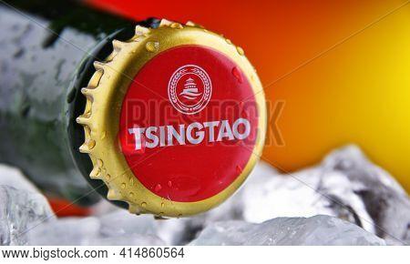 Poznan, Pol - Feb 25, 2021: Crown Cap On A Tsingtao Beer Bottle, Product Of Tsingtao Brewery, China'