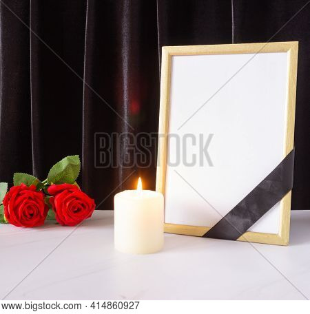 Photo Frame With Black Mourning Ribbon, Roses And Candle. The Concept Of Mourning And Funerals.
