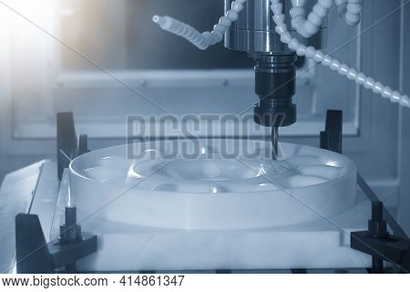 The  Cnc  Milling Machine Cutting  The Pom Material Part By Solid Ball  End-mill Tool. The Hi-precis