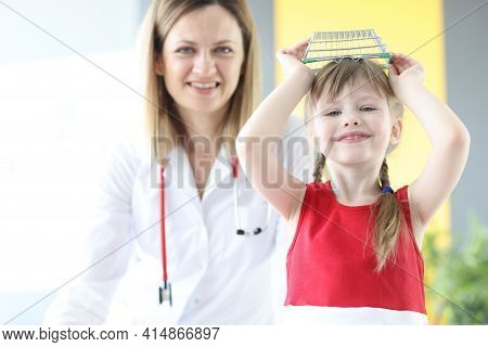 Little Girl Indulging In Appointment With Pediatrician In Clinic