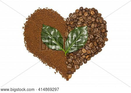 Double Coffee Heart Made From Beans And Instant Coffee And Green Leaves. Isolated On White. Fresh Ro