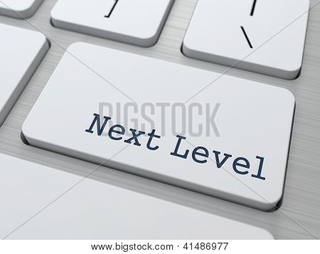 Next Level - Button on Modern Computer Keyboard. poster