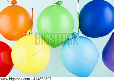 Small Inflatable Balls Of Rainbow Colors Hang On A Ribbon. Holiday Content.
