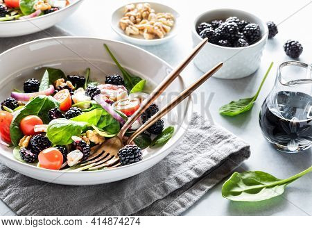 Close Up Of A Bowl Of Blackberry Spinach Salad Back Lit And Surrounded By Balsamic Vinaigrette, Waln