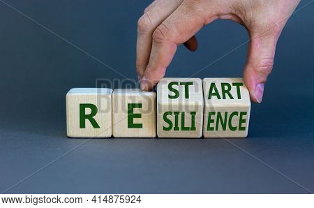 Restart And Resilience Symbol. Businessman Turns Cubes And Changes The Word 'restart' To 'resilience