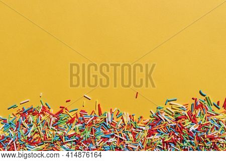 Rainbow Sugar Sprinkle Dots, Decoration For Cake And Bakery On Colored Backdrop. Colorful Sprinkles