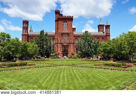 Washington, Usa - June 14, 2013: People Visit The Smithsonian Institution Castle In Washington Dc. 1