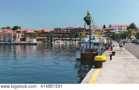 Nessebar, Bulgaria - July 21, 2014: Tourists Buy Fish On A Fishing Boat In Port Of Nesebar
