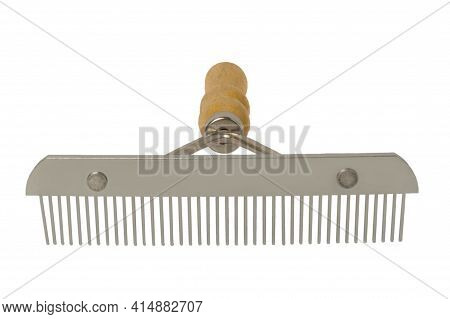 Stainless Steel Comb With Wooden Handle For Combing Pet Hair. Isolated On A White Background.