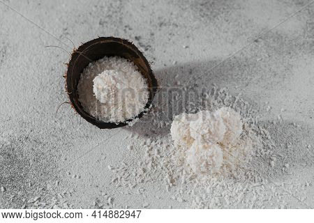 Coconut Healthy Sugarfree Balls In Coconut Shells With Coco Flakes On Light Gray White Background