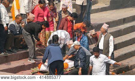 Kathmandu, Nepal - 8 October 2018: Local Hindu People, Traditional Cremation Ceremony At The Burning