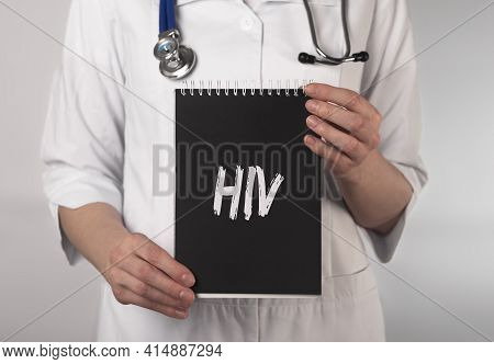 Hiv Acronym, Inscription On Paper In Doctor Hands.