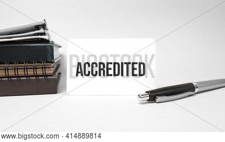 Paper Plate, Glasses, Notepad In Stack,pen And Text Accredited On Business Card