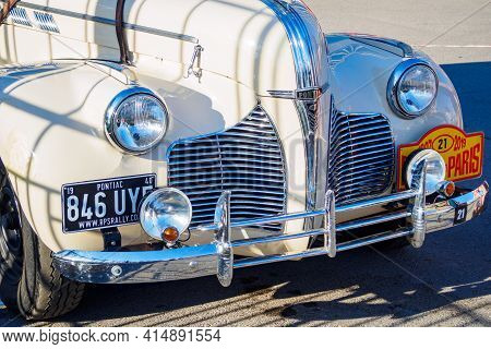 The 7th Peking To Paris Motor Challenge. Front View Of White Pontiac Coupe, American Car 1940 In Sun