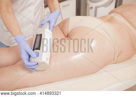 Cropped Shot Of Plus Size Woman Getting Endospheres Thighs Massage By Cosmetician