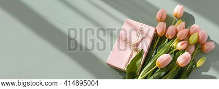 Bouquet Of Pink Tulips And Gift Box Isolated On Green Background With Shadow. Spring Flowers. Greeti