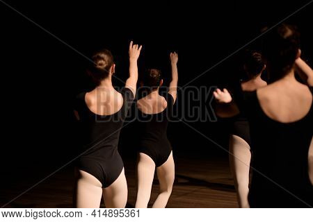 A Choreographed Dance Of A Group Of Graceful Pretty Young Ballerinas Practicing On Stage In A Classi