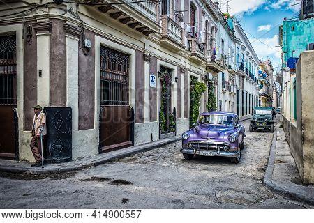 Havana, Cuba, July 2019, View Of A Purple Old American Classic Car Driving By Casa Martha A Guest Ho