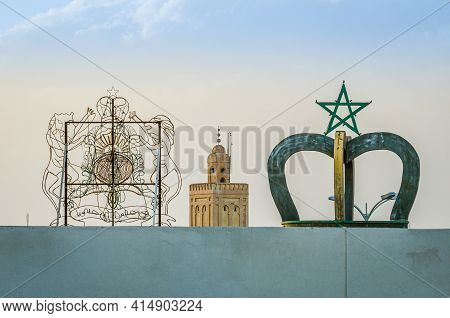 Midelt, Morocco - April 10, 2014.  Moroccan Symbols On The Roof With Minaret Tower