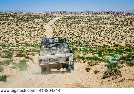 Zaida, Morocco - April 10, 2015. Silver Vintage Off Road Car Fully Loaded Going In The Dirt Road In