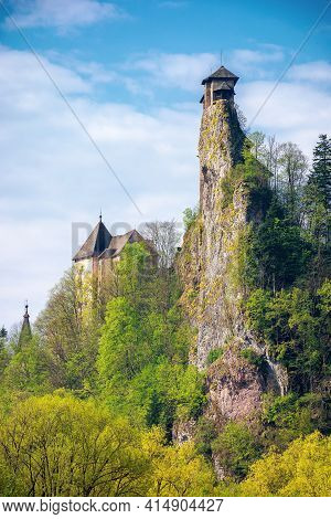 Oravsky Podzamok, Slovakia - May 01, 2019: Castle Tower On The Rock. Beautiful Sunny Landscape In Sp