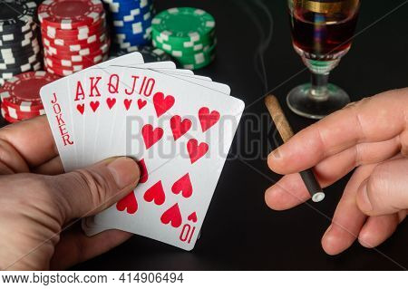 Poker Cards With Five Of A Kind Combination. Close Up Of A Gambler Hand Is Holding Playing Cards And