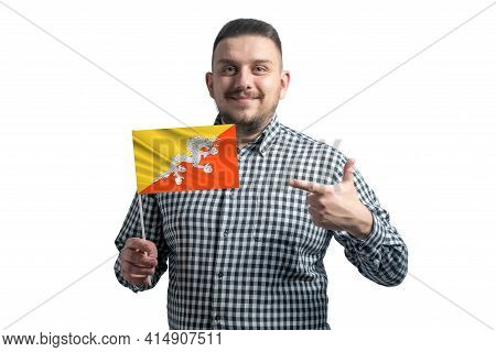 White Guy Holding A Flag Of Butane And Points The Finger Of The Other Hand At The Flag Isolated On A