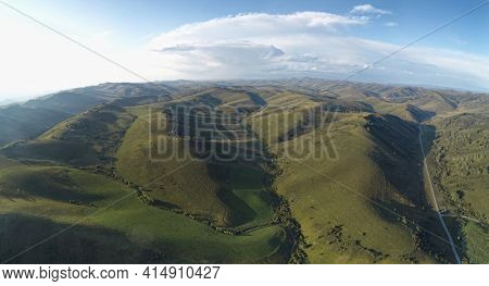 Drone view of autumn meadow hiils and forest. Aerial nature shot. Altai regoin, Russia