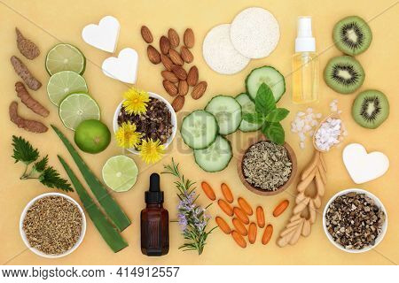 Natural skincare healing ingredients used to treat skin ailments including sunburn, acne, psoriasis, eczema and helps to reduce environmental damage. Flat lay on mottled yellow background.