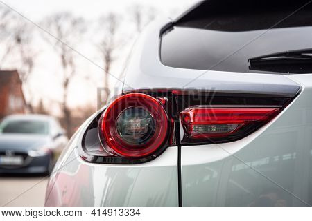 GDANSK, POLAND - MARCH 25, 2018: Rear lights of all electric Mazda MX-30 at the car showroom in Gdansk, Poland. Mazda MX-30 is the first all electric car from Mazda Motor Corporation.