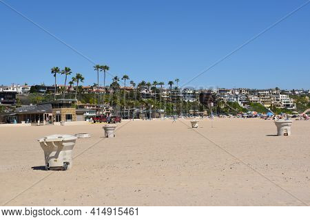 NEWPORT BEACH, CALIFORNIA - MARCH 28, 2017: Corona del Mar State Beach. People enjoing a beautiful Spring day at the shore.