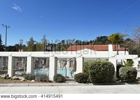 PASADENA, CALIFORNIA - 26 MAR 2021: Building and pool at the Rose Bowl Aquatics Center.