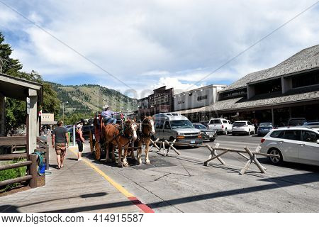 JACKSON HOLE, WYOMING - 27 JUNE 2017: Town Square Stagecoach Ride. Visitors can enjoy a Stagecoach Ride and tour of historic town.
