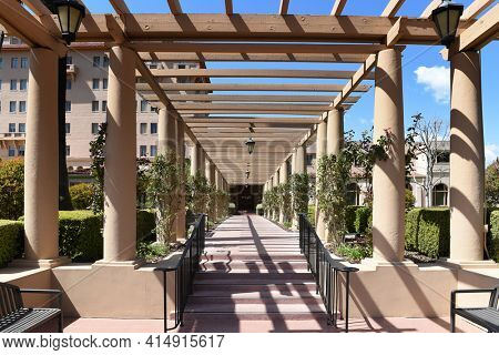 PASADENA, CALIFORNIA - 26 MAR 2021: Entrance and arbor covered walkway at the Richard H. Chambers United States Court of Appeals Building.