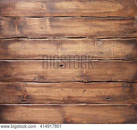 Wooden table top background or wall texture.  Brown wood board tabletop with copy space