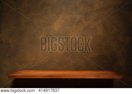 Wooden shelf and painted background texture as abstract wall surface. Book shelf at wall background of oil paint canvas