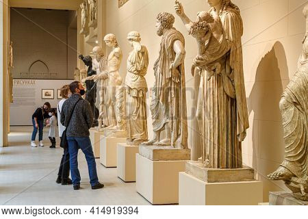 Moscow, Russia - January 26, 2021: People wearing protection mask in Pushkin Museum of Fine Arts is largest museum of Europe art in Moscow. Greek hall.