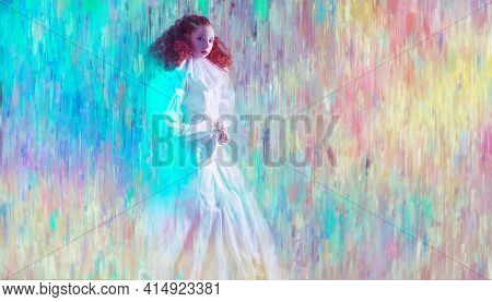 Sophisticated female model with lush red curly hair posing in a white art dress on multicolored background. A studio portrait with mixed red color lighting in haze. Fashion art.